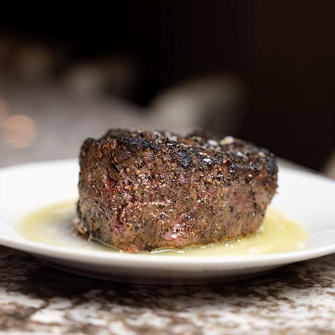 filet on white plate